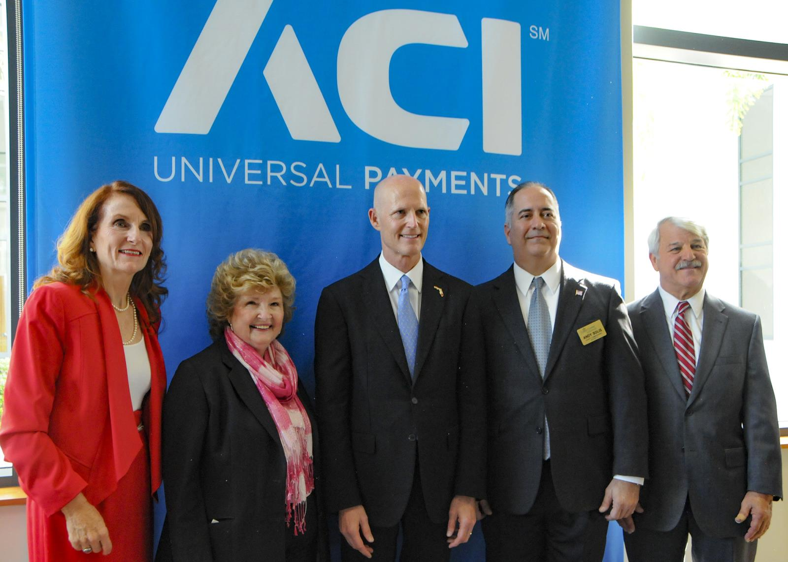 Commissioners Taylor, Fiala, Solis and Saunders with Governor Rick Scott at ACI Universal Payment Company Ribbon Cutting